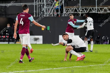 Aleksander Mitrovic of Fulham reacts on the ground at full-time as the 0-2 loss means Fulham are relegated from the Premier League