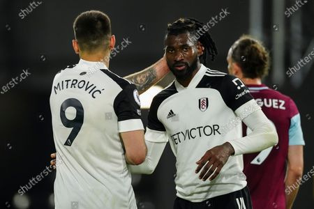 Aleksander Mitrovic of Fulham consoles Andre Frank Zambo Anguissa of Fulham at full-time as the 0-2 loss means Fulham are subsequently relegated from the Premier League
