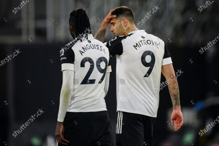 Andre Frank Zambo Anguissa of Fulham and Aleksander Mitrovic of Fulham walks off the pitch together at full-time as the 0-2 loss means Fulham are subsequently relegated from the Premier League
