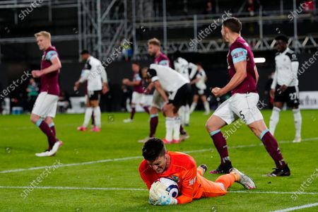 Nick Pope of Burnley holds onto the ball after denying Fulham a chance at goal
