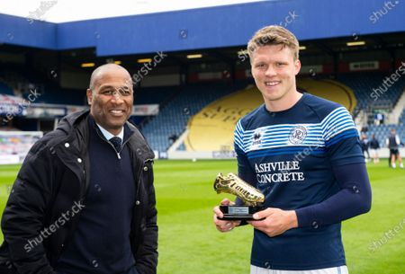 Rob Dickie is presented with the Goal of the Season award by Les Ferdinand QPR Director of Football
