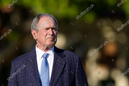 Former President George W. Bush listens to speakers during the opening ceremony of the Walker Cup golf tournament, which starts tomorrow, at Seminole Golf Club in Juno Beach, Fla., . The tournament was founded by George Herbert Walker, the United States Golf Association president in 1920, who was the great-grandfather of Bush
