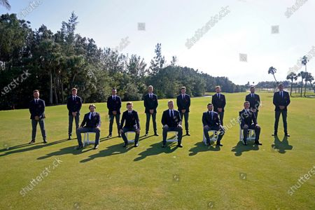 The Great Britain and Ireland team players pose socially distanced for a team photo during opening ceremonies for the Walker Cup golf tournament, which starts Saturday, at Seminole Golf Club in Juno Beach, Fla., . From left in front are Joe Long, Angus Flanagan, captain Stuart Wilson, Alex Fitzpatrick and Ben Jones. In back from left are Matty Lamb, Ben Schmidt, Joe Pagdim, Jack Dyer, Mark Power, John Murphy, Jake Bolton and Barclay Brown
