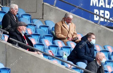 Rotherham Chairman Tony Stewart checks his phone.