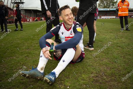 Stock Photo of Gethin Jones of Bolton Wanderers enjoys a beer on the pitch