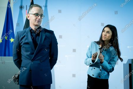 Stock Image of German Foreign Minister Heiko Maas (L) and Iraqi human rights activist and Nobel Peace Prize laureate Nadia Murad (R) symbolically open the College 'Women, Peace and Security' at the Foreign Service Academy in Berlin-Tegel in Berlin, Germany, 07 May 2021.