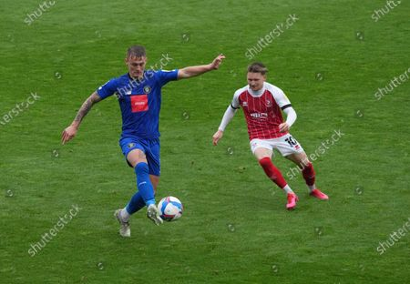 Will Smith of Harrogate Town and Alfie May of Cheltenham Town