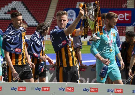 Stock Image of James Scott of Hull City celebrates winning League One