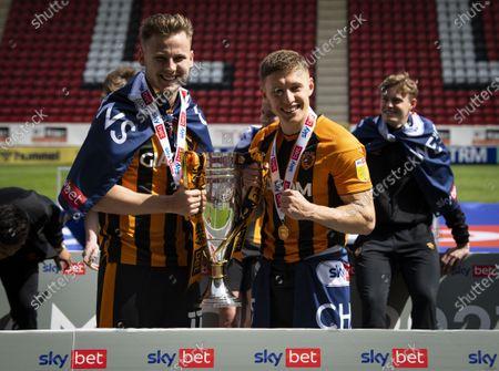 James Scott of Hull City and Greg Docherty of Hull City celebrate winning League One