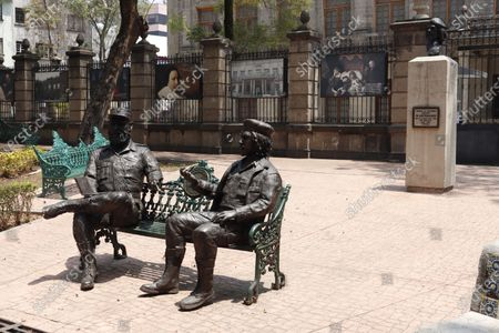 """Sculptures of the  leaders of the Cuban revolution, Fidel Castro,  and Ernesto """"Che"""" Guevara, are seen at Tabacalera Park in Mexico City. In commemorating the 30th anniversary of his fall in Bolivia, 1967 - 1997. The sculptures were created in 2017 by sculptor Oscar Ponzanelli. on May 6, 2021 in Mexico City, Mexico."""