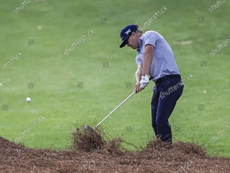 Stock Picture of Zach Johnson of the US catches pine straw as he hits on the twelfth rough during the second round of the Wells Fargo Championship golf tournament at Quail Hollow Club in Charlotte, North Carolina, USA, 07 May 2021. The Wells Fargo Championship will be played 06 May through 10 May.