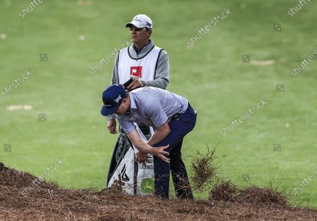 Zach Johnson of the US clears pine straw from near his ball as he prepares to hit his second shot on the twelfth hole during the second round of the Wells Fargo Championship golf tournament at Quail Hollow Club in Charlotte, North Carolina, USA, 07 May 2021. The Wells Fargo Championship will be played 06 May through 10 May.