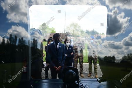 French Defence Minister Florence Parly (C-R) and French Secretary of State and Government's spokesperson Gabriel Attal (C-L) are seen behind a window reflection during a visit to the military camp of Satory in Versailles-Satory, west of Paris, France, 07 May 2021.