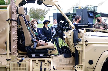 French Defence Minister Florence Parly (L) looks at an army vehicle during a visit to the military camp of Satory in Versailles-Satory, west of Paris, France, 07 May 2021.