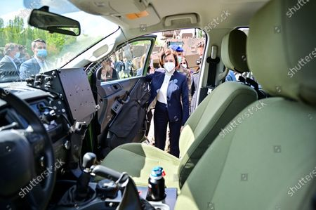 French Defence Minister Florence Parly looks at an army vehicle during a visit to the military camp of Satory in Versailles-Satory, west of Paris, France, 07 May 2021.