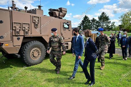 French Defence Minister Florence Parly (R) and French Secretary of State and Government's spokesperson Gabriel Attal (C) listen to explanationsduring a visit to the military camp of Satory in Versailles-Satory, west of Paris, France, 07 May 2021.