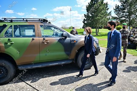 French Defence Minister Florence Parly (C) and French Secretary of State and Government spokesperson Gabriel Attal (R) visit the military camp of Satory in Versailles-Satory, west of Paris, France, 07 May 2021.