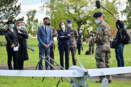 French Defence Minister Florence Parly (C-R) and French Secretary of State and Government's spokesperson Gabriel Attal (C-L) listen to explanations during a visit to the military camp of Satory in Versailles-Satory, west of Paris, France, 07 May 2021.