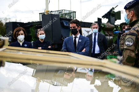 French Defence Minister Florence Parly (L) and French Secretary of State and Government's spokesperson Gabriel Attal (C) listen to explanations during a visit to the military camp of Satory in Versailles-Satory, west of Paris, France, 07 May 2021.