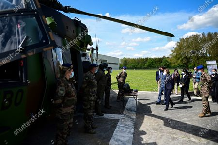 French Defence Minister Florence Parly (C) and French Secretary of State and Government's spokesperson Gabriel Attal (C-L) visit the military camp of Satory in Versailles-Satory, west of Paris, France, 07 May 2021.
