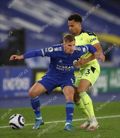 Leicester's Marc Albrighton, left, and Newcastle's Jacob Murphy challenge for the ball during the English Premier League soccer match between Leicester City and Newcastle United at the King Power Stadium in Leicester, England