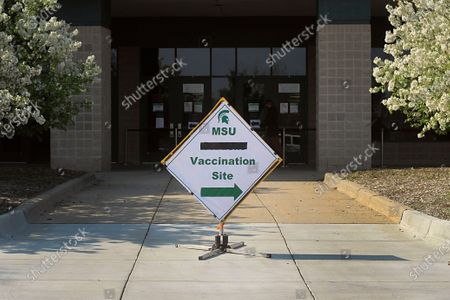 Stock Image of Sign outside the Michigan State University Pavilion directs people to a vaccination site at the university, in East Lansing, Mich. Michigan State University offers walk-in and drive-thru COVID-19 vaccines at the pavilion and the vaccine clinic has provided the university community and public with nearly 5,000 doses, University spokesman Dan Olsen said