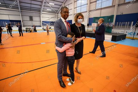 Picture shows Vaughan Gething with his son and wife celebrating after winning Cardiff South and Penarth during the count for the Senedd elections in the House of Sport, Cardiff.