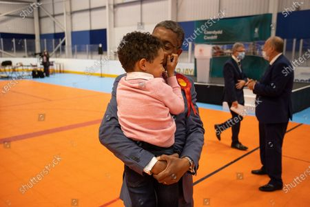 Picture shows Vaughan Gething with his son celebrating after winning Cardiff South and Penarth during the count for the Senedd elections in the House of Sport, Cardiff.