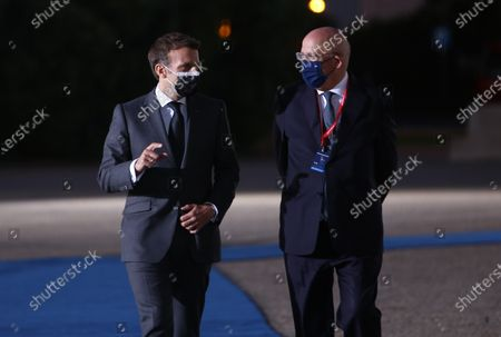 French President Emmanuel Macron (L) and Portuguese Minister for Foreign Affairs Augusto Santos Silva arrive at Palacio de Cristal Congress Center during the European Social Summit, in Porto, Portugal, May 7, 2021. Hosted by the Portuguese Presidency of the Council of the European Union the Summit will pay particular attention to the areas of Employment, Equal Opportunities, Inclusion, Social Protection and Health.