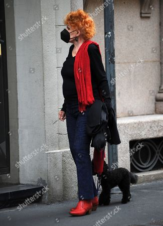 Stock Picture of Ornella Vanoni with her little dog Ondina.
