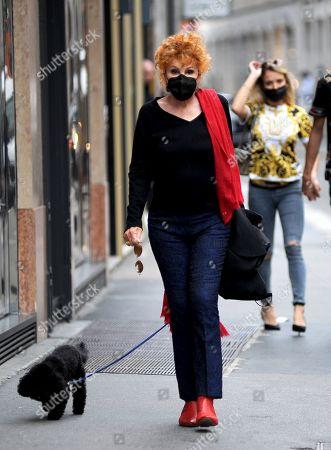 Ornella Vanoni with her little dog Ondina.