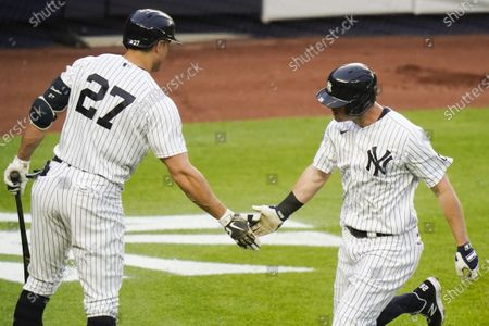 New York Yankees' DJ LeMahieu, right, celebrates with Giancarlo Stanton (27) after hitting a home run during the first inning of a baseball game against the Washington Nationals, in New York