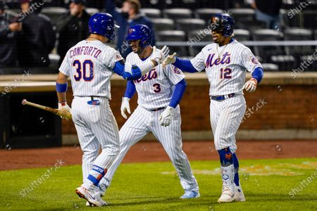 New York Mets' Francisco Lindor (12) celebrates with Tomas Nido (3) and Michael Conforto (30) after hitting a two-run home run off Arizona Diamondbacks pitcher Caleb Smith during the seventh inning of a baseball game, in New York