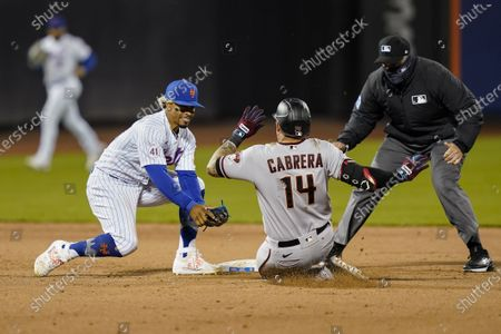 Arizona Diamondbacks' Asdrubal Cabrera (14) is tagged out at second by New York Mets shortstop Francisco Lindor, left, while trying to stretch a single during the ninth inning of a baseball game, in New York