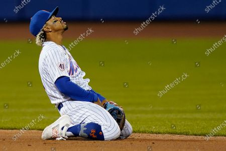 New York Mets shortstop Francisco Lindor reacts after a failed double-play attempt on a ball hit by Arizona Diamondbacks' Zac Gallen during the third inning of a baseball game, in New York. A runner was forced at second, and a run scored