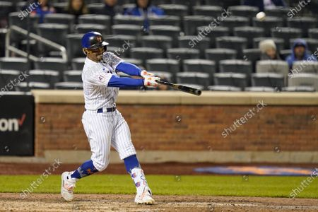 New York Mets' Francisco Lindor hits a two-run home run off Arizona Diamondbacks pitcher Caleb Smith during the seventh inning of a baseball game, in New York