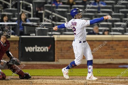 New York Mets' Francisco Lindor watches his two-run home run off Arizona Diamondbacks pitcher Caleb Smith during the seventh inning of a baseball game, in New York