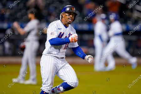 New York Mets' Francisco Lindor runs the bases after hitting a two-run home run off Arizona Diamondbacks relief pitcher Caleb Smith during the seventh inning of a baseball game, in New York