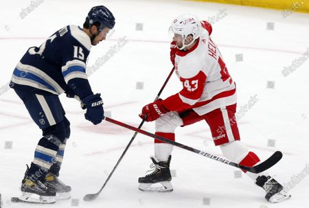 Stock Picture of Detroit Red Wings forward Darren Helm, right, works against Columbus Blue Jackets defenseman Michael Del Zotto during the first period of an NHL hockey game in Columbus, Ohio