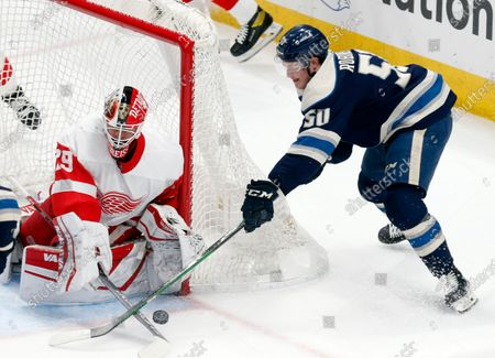 Stock Picture of Detroit Red Wings goalie Thomas Greiss, left, stops a shot by Columbus Blue Jackets forward Eric Robinson during the first period of an NHL hockey game in Columbus, Ohio
