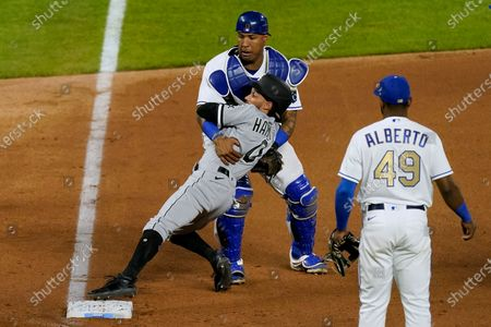 Stock Image of Kansas City Royals catcher Salvador Perez catches Chicago White Sox's Billy Hamilton (0) after colliding with him while chasing Zack Collins back to third as Collins tried to score on a ball hit by Nick Madrigal during the seventh inning of a baseball game, in Kansas City, Mo. Collins was ruled out at home on the play