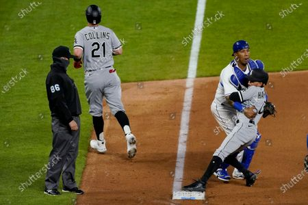 Kansas City Royals catcher Salvador Perez catches Chicago White Sox's Billy Hamilton (0) after colliding with him while chasing Zack Collins back to third as Collins tried to score on a ball hit by Nick Madrigal during the seventh inning of a baseball game, in Kansas City, Mo. Collins was ruled out at home on the play