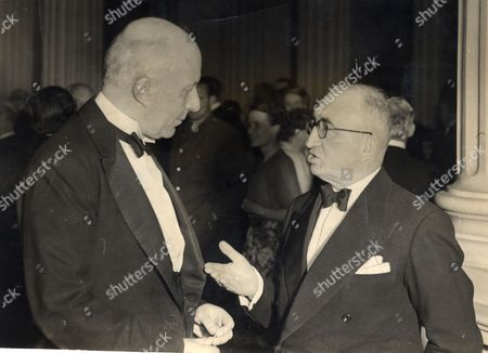 Edward Hugh John Neale Dalton The Right Honourable The Lord Dalton (chancellor Of The Duchy Of Lancaster Chancellor Of The Exchequer) Died 13/02/1962 At The Age Of 75. Baron Dalton Is Seen Chatting With Sir Charles Lidbury President Of The Institute Of Bankers.