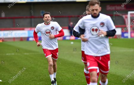 Mark Wright of Crawley and former TOWIE star wearing the Stop the Stabbing Stick to jabbing shirt during the warm up before the Sky Bet League Two match between Crawley Town and Bolton Wanderers at the People's Pension Stadium  , Crawley ,  UK - 8th May 2021
