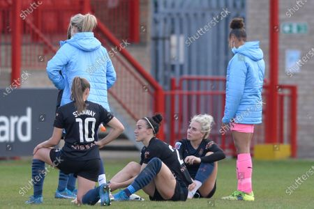 (L-R) Georgia Stanway, Lucy Bronze and Alex Greenwood of Manchester City Women reacts after the WomenÕs Super League match between West Ham Women and Manchester City Women at The Chigwell Construction Stadium in London - 9th May 2021