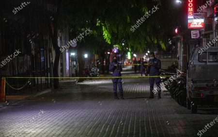 Maldives police officers stand guard outside the cordoned-off area of a blast in Male, Maldives, 08 May 2021. Maldives former president and current parliament speaker Mohamed Nasheed was injured in a blast outside his family home on 06 May and was admitted to hospital in critical condition.
