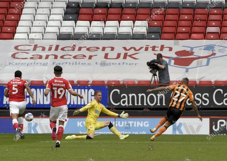 Charlton goalie Ben Amos saves the shot from Hull Citys' Magennis; The Valley, London, England; English Football League One Football, Charlton Athletic versus Hull City.