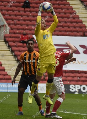 Goalkeeper Ben Amos collects the ball from a cross; The Valley, London, England; English Football League One Football, Charlton Athletic versus Hull City.