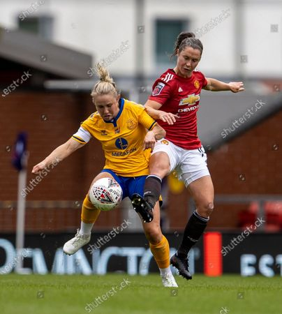 Jane Ross of Manchester United Women tackles Izzy Christiansen of Everton Women; Leigh Sports Village, Lancashire, England; Women's English Super League, Manchester United Women versus Everton Women.
