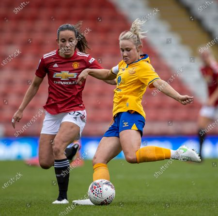 Stock Picture of Izzy Christiansen of Everton Women passes the across Lucy Staniforth of Manchester United Women; Leigh Sports Village, Lancashire, England; Women's English Super League, Manchester United Women versus Everton Women.